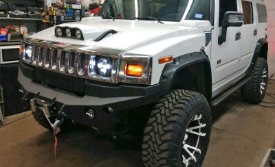 Rockstar 3 wheels with white split spokesPIAA light bars | Custom made Roof Mount system | Xenon flare kit| Amp research boards (automatic hideaways)