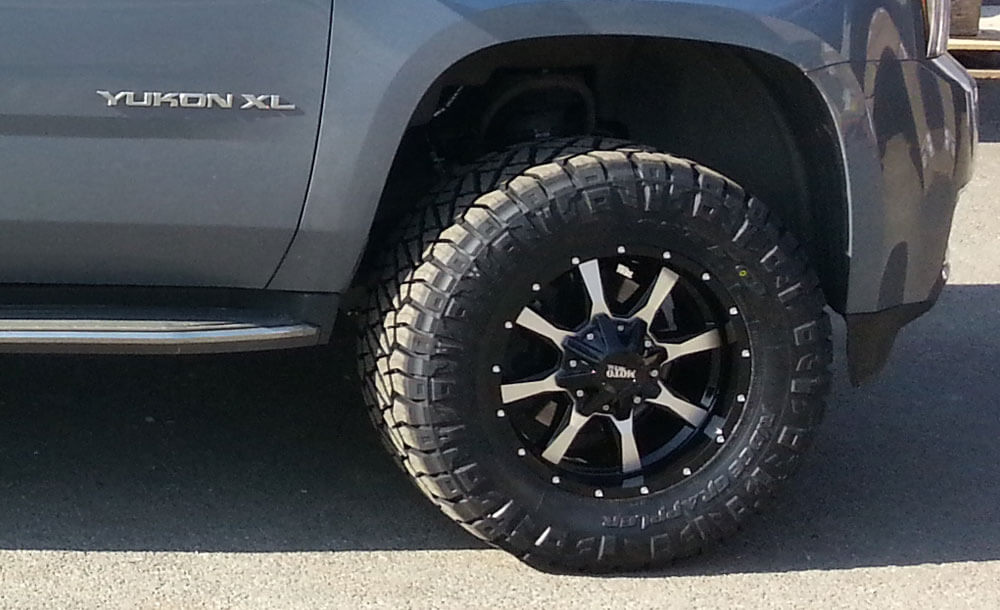 Moto Metal wheels and 33 inch Nitto Ridge Grappler tires