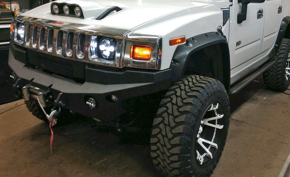 Rockstar 3 wheels with white split spokes | Toyo Open Country m/t tires